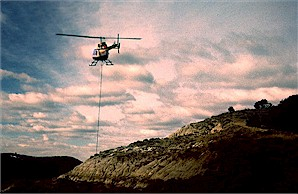 Figure 22d. Field jacket containing champsosaur skeleton being air-lifted from the excavation site. Photograph by Bruce Kaye, Theodore Roosevelt National Park.