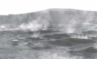 Open burning near Belfield (Slope County) of uraniferous lignite to produce an ash concentrate.