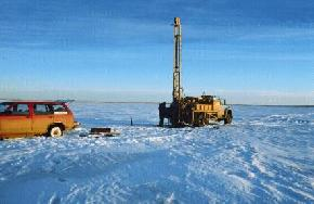 There are only a few ways to obtain sediment samples from beneath these lakes: hand augering in the late fall,  								drilling from a floating platform (barge) during the summer, or drilling with a truck mounted rig in the winter when the lake has sufficiently frozen. The North Dakota Geological Survey  								chose to drill in the winter and had to contend with temperatures that ranged from 30 to -24 degrees Fahrenheit). (Photo by E. Murphy, NDGS).