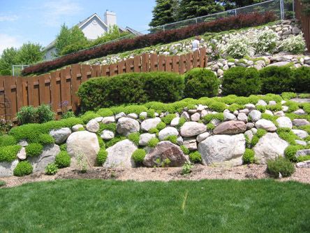 Landscaping in Bismarck, using glacial erratics and field stones.