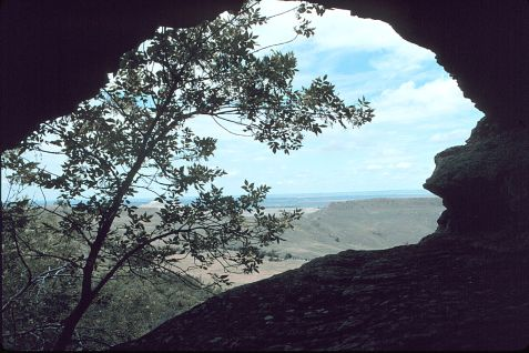 Photograph of entrance of Bear Cave from the back of the cave looking towards the town of New England