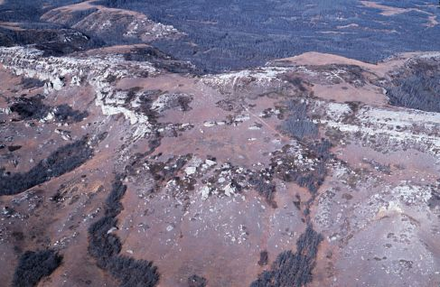 Aerial photograph of the southeast end of South Killdeer Mountain. The trail leading up to Medicine Hole Plateau is visible in the foreground.